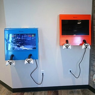 Video games on the wall for the kiddos at Smile Surfers