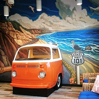 Contact Smile Surfers in Sumner where you'll find a VW van in the wall
