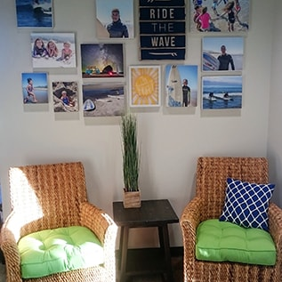 Waiting room with surf photos at Smile Surfers in Sumner, WA