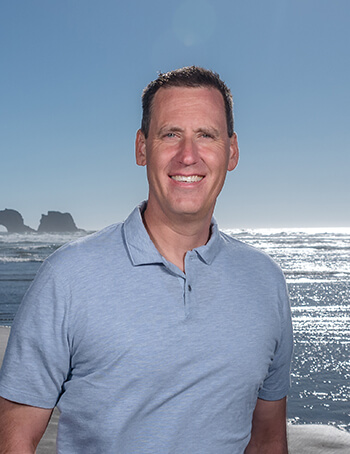 A portrait of Dr. Jared Lothyan at the beach